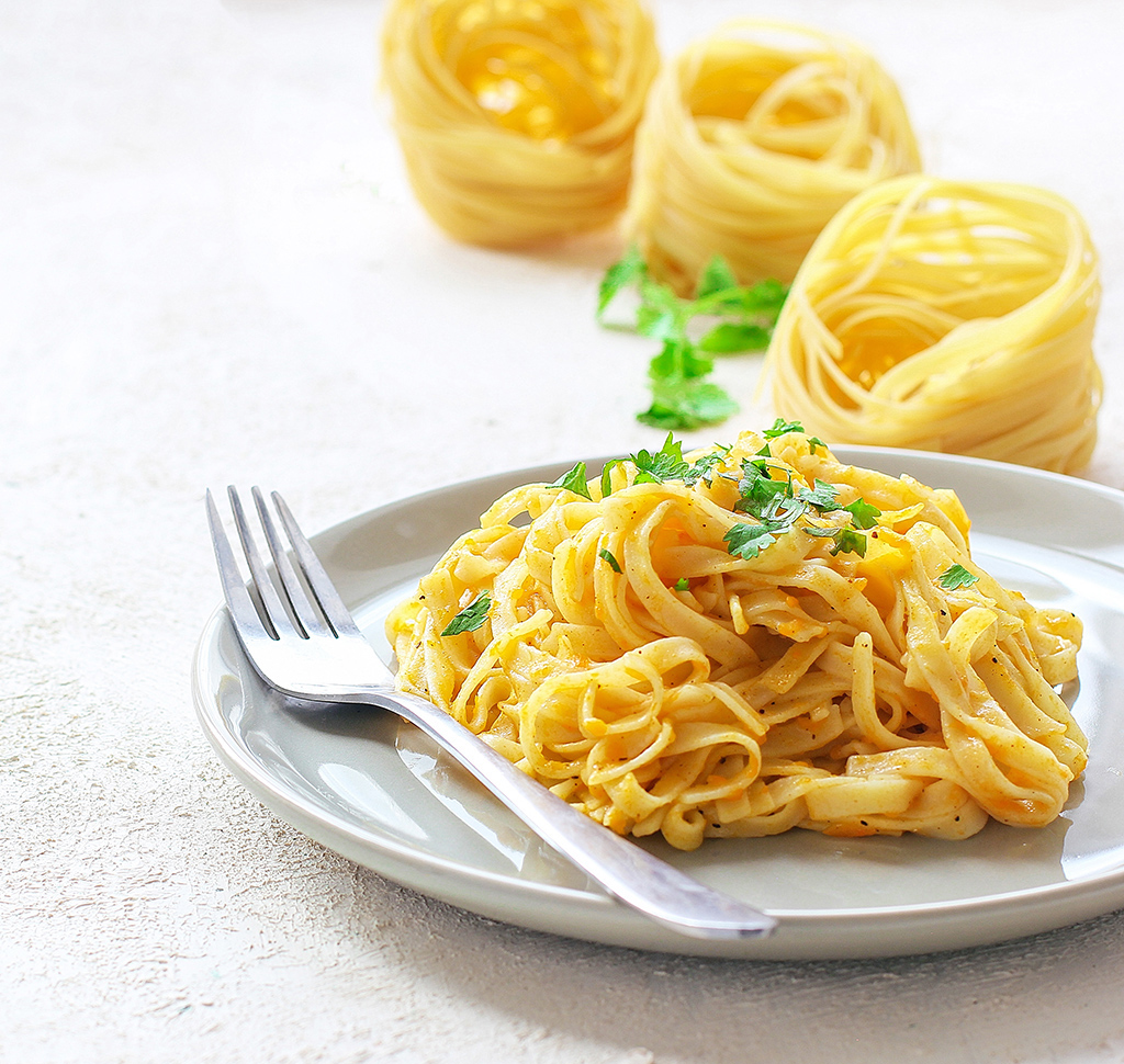 Fettuccini with basil on top