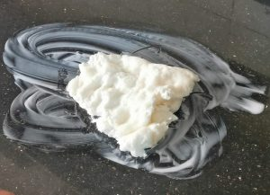 Air dry clay on a lotion covered surface ready to be kneaded