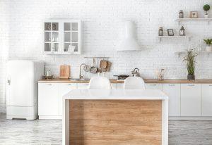Modern stylish Scandinavian kitchen interior with kitchen accessories. Bright white kitchen with household items