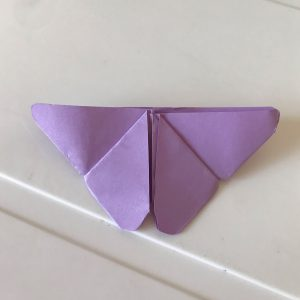 Butterfly purple origami over a white table