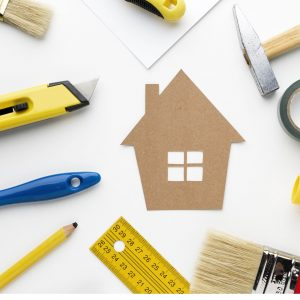 home improvement illustration with tools and house cardboards