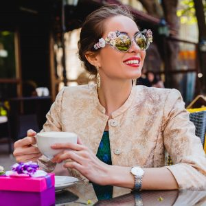 young woman wearing flower sunglasses