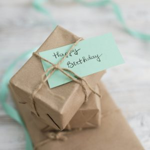 Gift wrap with a green note