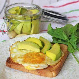 Pickled avocado over a fried egg