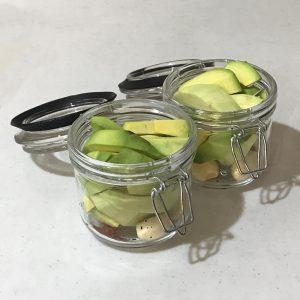 Avocado slices in jars