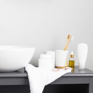 well arranged containers over a sink