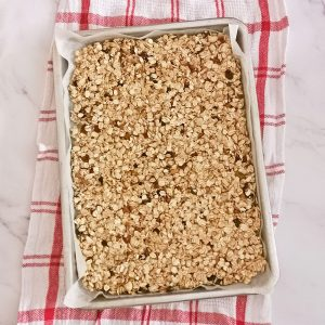 A granola tray over a kitchen towel