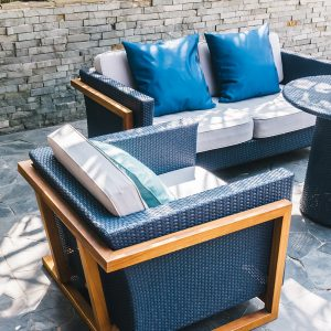 Outdoor patio with blue cozy seating