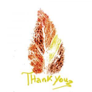 An autumn leave print on a thank you card