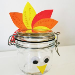 An air tight container with autumn leaves behind